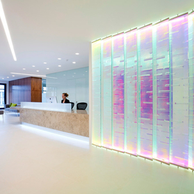 dichroic glass feature wall in office lobby